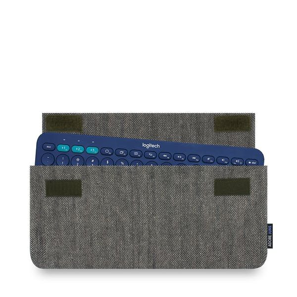 The picture shows the front of Keeb Business Sleeve for Logitech K380 Multi-Device Keyboard in color Grey / Black; As an illustration, it also shows what the compatible device looks like in this bag
