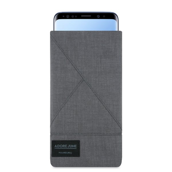 The picture shows the front of Triangle Sleeve for Samsung Galaxy S9 Plus in color Dark Grey; As an illustration, it also shows what the compatible device looks like in this bag