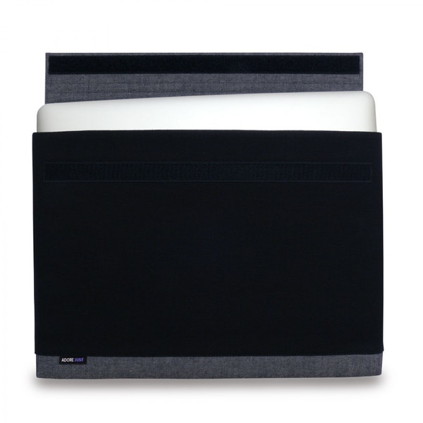 The picture shows the front of Bold Sleeve for Apple MacBook Pro 15 2012-2015 in color Grey / Black; As an illustration, it also shows what the compatible device looks like in this bag