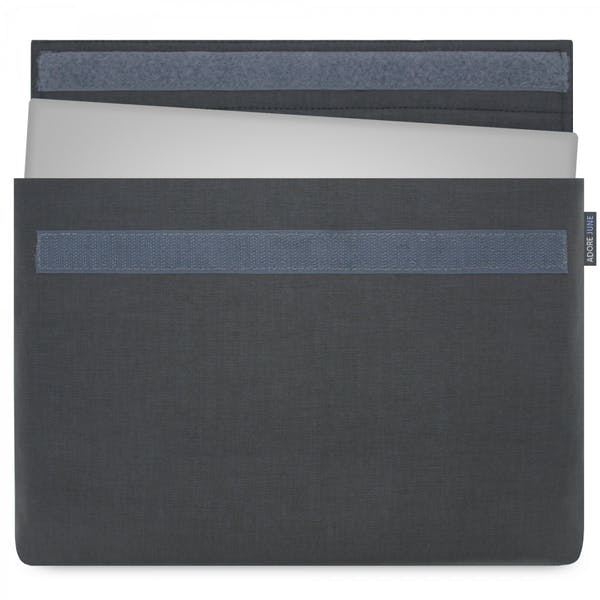 The picture shows the front of Classic Sleeve for Dell XPS 13 in color Dark Grey; As an illustration, it also shows what the compatible device looks like in this bag